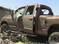 A truck displays the damage a tornado can do to a vehicle.