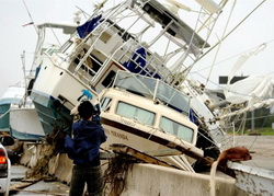 A TV cameraman tapes the wreckage left by Hurricane Ike In Galveston.  Bob Pearson / EPA