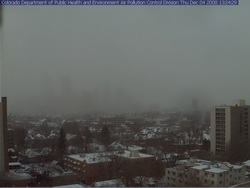 Where's Denver?  This webcam view from the Colorado Department of Public Health and Environment shows Denver obscured in the snowfall at 1:00pm Thursday.