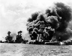 December 7, 1941.  From left, the USS USS West Virginia, USS Tennessee, both damaged and USS Arizona, sunk.  The weather played a key part in the attack on Pearl Harbor.