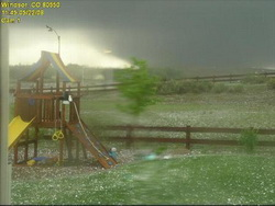 This amazing image of the Windsor tornado was taken from a backyard webcam.  Image courtesy MyWindsorWeather.com.