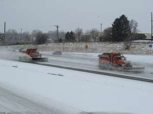 CDOT snowplows on I-25